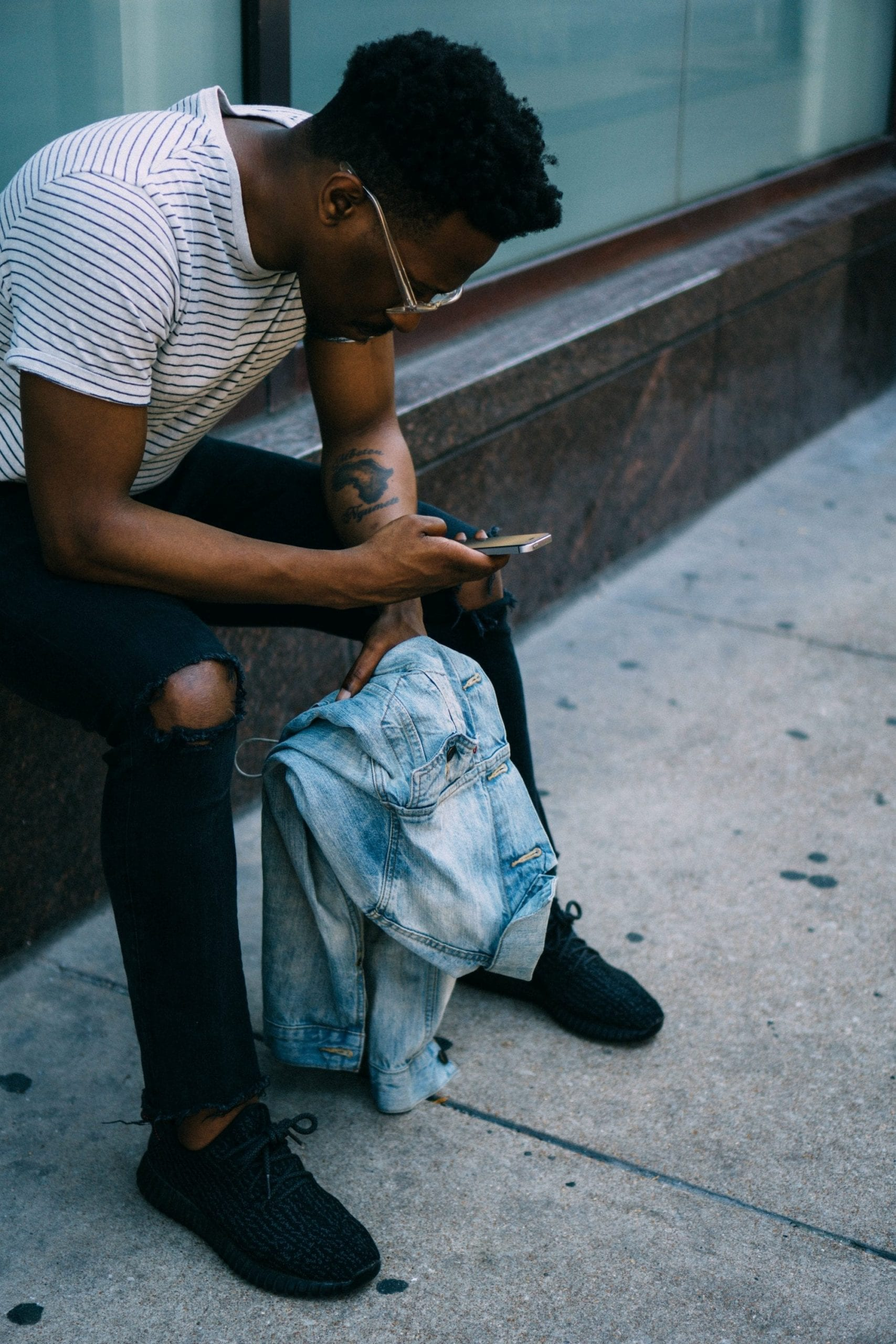 Sitting looking at phone - unsplash.com